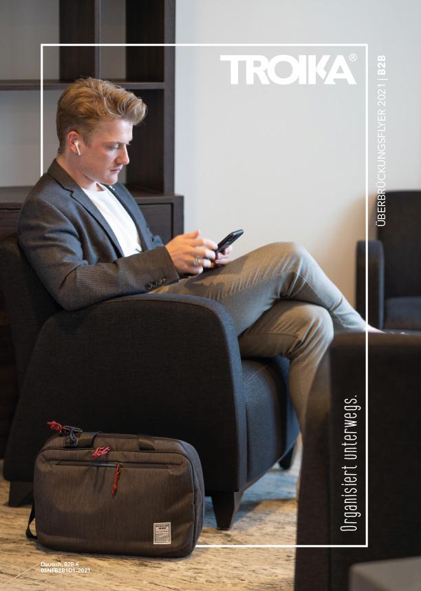 Titel TROIKA Katalog Neuheiten Januar 2021,  Geschäftsmann sitzt mit Handy in der Hand in Hotellobby
